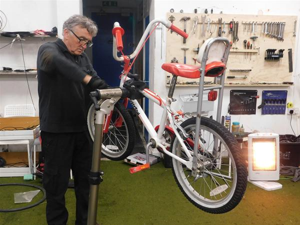 hugh fixing bike.JPG